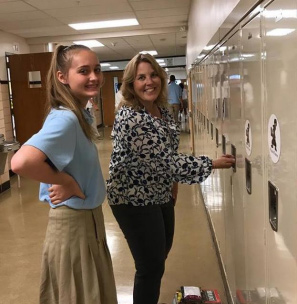 Teacher Helps Student with Locker